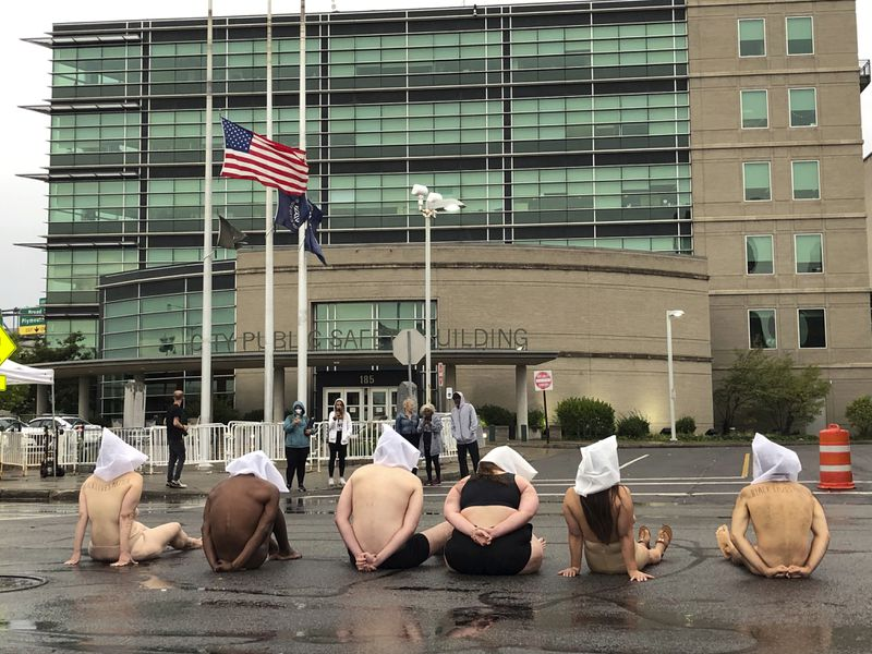 Naked protesters outside of the Public Safety Building (Tracy Schuhmacher/AP)